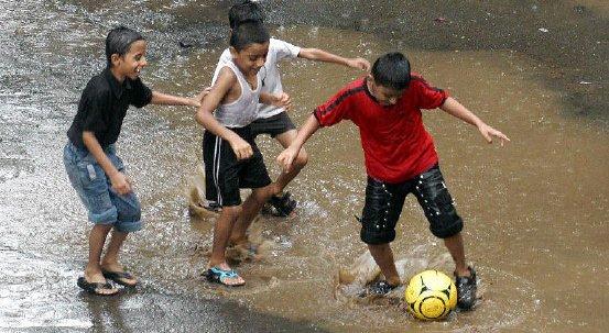 children-playing-football-in-rain-12.jpg